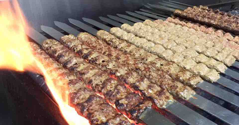 Kabab Koobideh cooking on an open grill