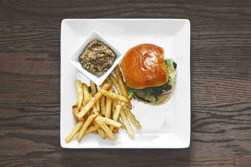 burger and chips on a plate for the perfect burger