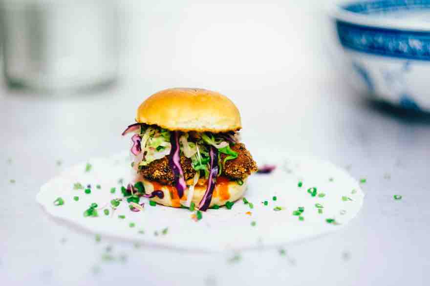 what makes the perfect burger recipes. nice burger on a white plate