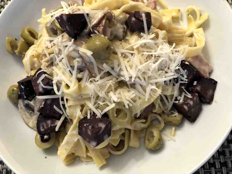 Tagliatelle with ham olives and black pudding